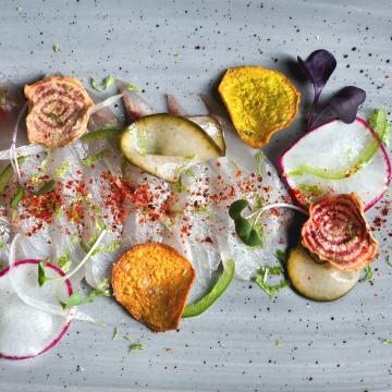 Snapper Crudo sliced radish, dill, pickled cucumber, jalapeno, beet chips, spring onions, espelette